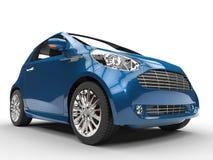 Mörker - blåa kompakta bil- Front Closeup View Arkivfoton