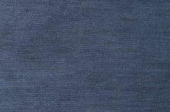 Mörker - blått, grov bomullstvilltextur Tygtextur av jeansen Arkivbild