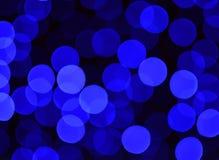 Mörker - blått- och svartbokehbakgrund Arkivfoton