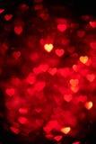 Mörker - för hjärtabokeh för röd färg foto för bakgrund Abstrakt ferie berömbakgrund royaltyfri fotografi