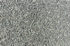 Mörker - grå asfalttextur Bakgrund och textur för design Royaltyfri Foto