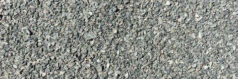 Mörker - grå asfalttextur Bakgrund och textur för design Arkivfoton