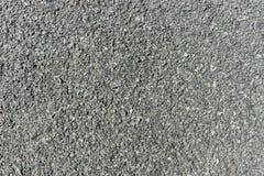 Mörker - grå asfalttextur Bakgrund och textur för design Arkivfoto