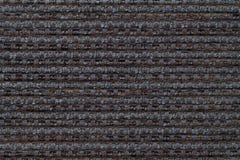 Mörker - grå bakgrund från den rutiga modelltextilen, closeup Struktur av den vide- tygmakroen royaltyfri foto