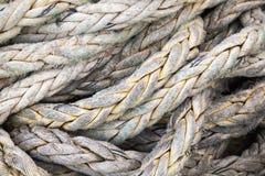 Mörker - grått nautiskt rep, bakgrundstextur Arkivfoton