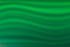 Mörker - grön bakgrund med ljus - gröna vågor Arkivfoto
