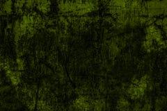 Mörker - grön grunge texturerad vägg Arkivfoto