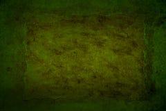 Mörker - grön grungy bakgrund Arkivfoto