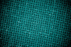 Mörker - grön kanfasbakgrund arkivfoton