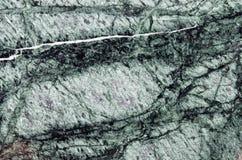 Mörker - grön marmortexturbakgrund, abstrakt naturlig textur f Arkivfoto