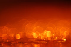 Mörker - orange cirkelbakgrund Arkivfoton
