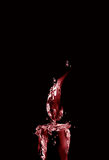 Mörker - röd julljus Arkivbild
