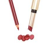 Mörker - röd kanteyeliner och läppstift på vit bakgrund Royaltyfri Fotografi