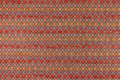 Mörker - röd orange bakgrund för ang med geometriska modeller Royaltyfri Fotografi