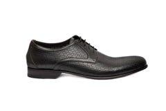 Mörkermanlig shoe-12 Arkivbild