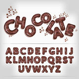 Mörkt alfabet för chokladgodis Fotografering för Bildbyråer