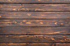 mörkt gammalt trä för bräde arkivfoto