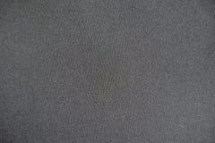 Mörkt grått icke-utskrivet tyg från över Royaltyfri Bild