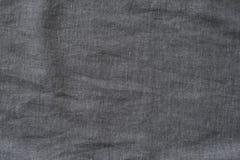 Mörkt - grått texturerat tyg Närbild Bakgrund arkivfoton