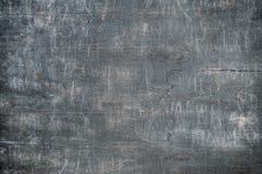 Mörkt greay träbräde med skrapor Fotografering för Bildbyråer