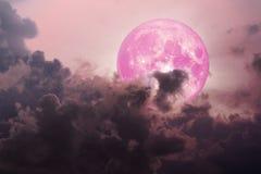 mörkt magentafärgat moln för rosa månebaksida över havet stock illustrationer
