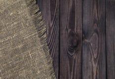 Mörkt trä med gammal säckvävtextur, bästa sikt royaltyfri foto