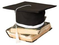 Mörtelvorstand auf einem Stapel Büchern Stockfotografie