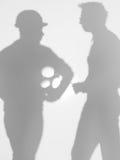 Möta mellan leverantören och iscensätta, silhouette Royaltyfri Fotografi