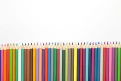 Múltiplo del lápiz de los colores en blanco Imagen de archivo libre de regalías