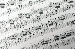 A música anota o fundo Imagens de Stock