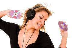 Música de escuta da mulher Fotografia de Stock