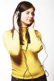 Música de escuta da mulher Imagem de Stock Royalty Free