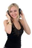 Música de escuta da mulher nova Fotos de Stock