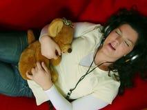Música de escuta da rapariga Imagens de Stock
