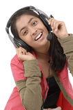 Música de escuta da rapariga Foto de Stock Royalty Free