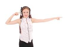 Música de escuta do adolescente bonito em seus fones de ouvido imagens de stock