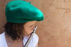 Música de la flauta de la muchacha Fotografía de archivo