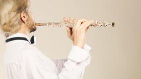 Música de la flauta que juega al ejecutante del músico del flautista Fotos de archivo libres de regalías