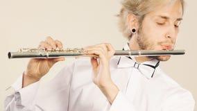 Música de la flauta que juega al ejecutante del músico del flautista Imagenes de archivo