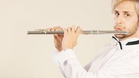 Música de la flauta que juega al ejecutante del músico del flautista Imagen de archivo libre de regalías