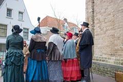 Música de natal do Natal do canto dos povos do festival de Dickens Fotos de Stock Royalty Free