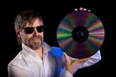 Música del amante con el disco laser Imagen de archivo