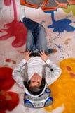 Música del hombre joven, pared de la pintada Imagen de archivo libre de regalías