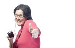 Música del mp3 de la tecnología de la mujer Imagen de archivo libre de regalías