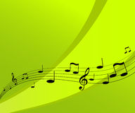 Música del vuelo en fondo verde. Imagen de archivo libre de regalías