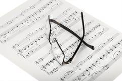 Música e vidros de folha Imagens de Stock