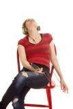 A música latino da mulher senta-se dirige para trás Fotos de Stock