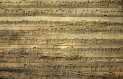 A música nota a textura de madeira Foto de Stock