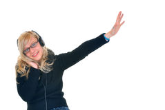 Música que escucha con el receptor de cabeza Foto de archivo libre de regalías