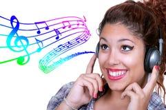 Música que escucha de la chica joven Fotografía de archivo